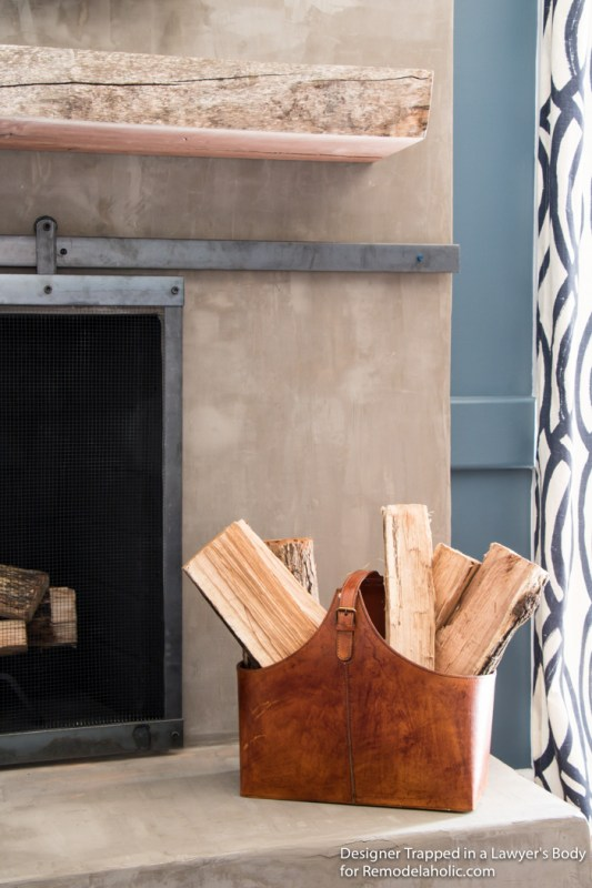 Learn how to install a wood mantel (even if it's SUPER heavy) with this easy tutorial from Designer Trapped in a Lawyer's Body for Remodelaholic.com!