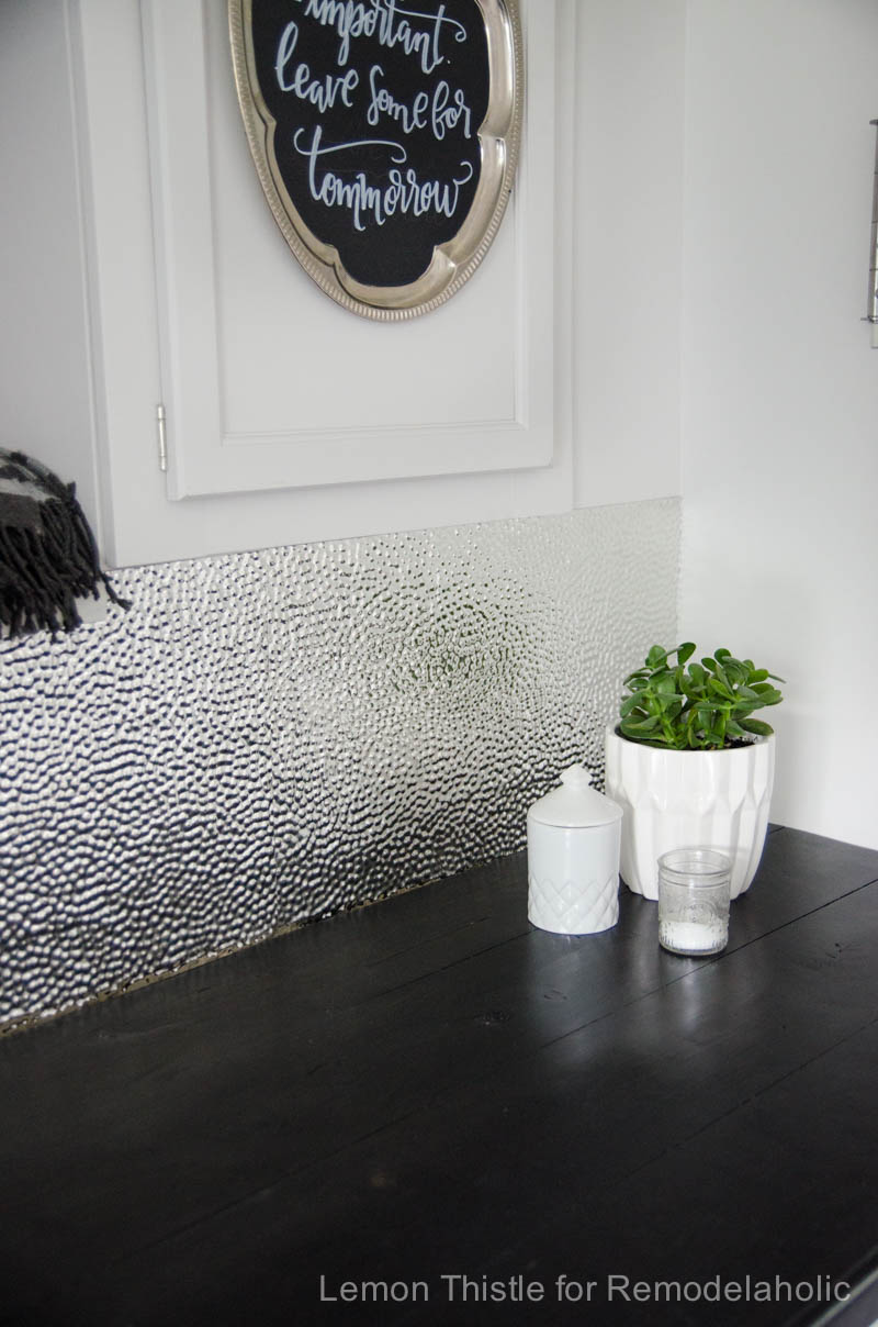 Remodelaholic how to install a metal ceiling tile backsplash a textured metal ceiling tile backsplash is chic modern and durable and dailygadgetfo Choice Image
