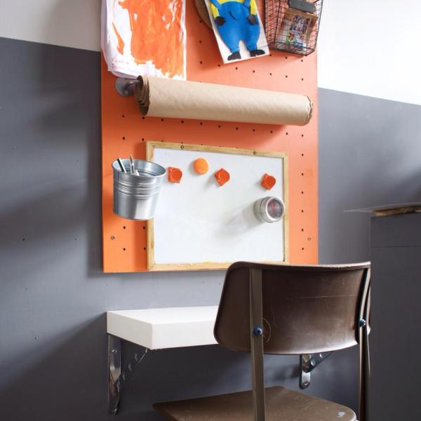 use IKEA buckets and wall rails on a pegboard for a kids art station by Grillo Designs