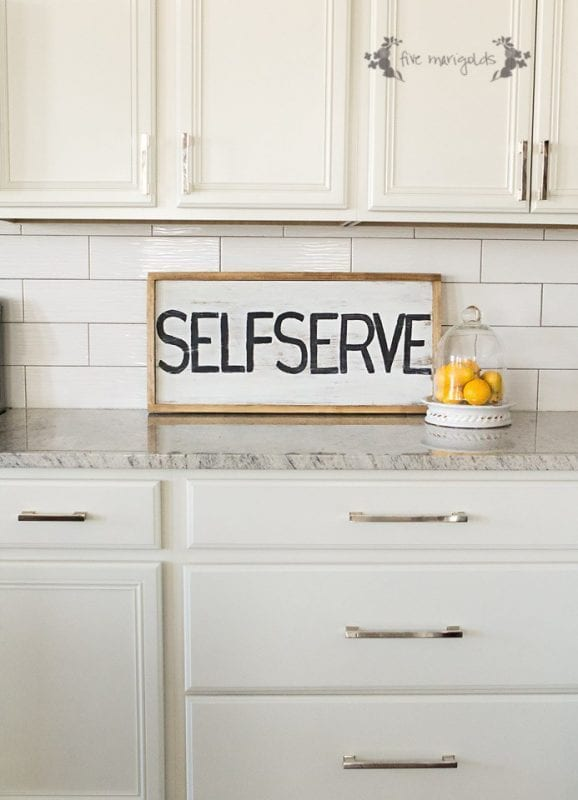 white-kitchen-with-self-serve-reversible-sign-Five-Marigolds-578x800