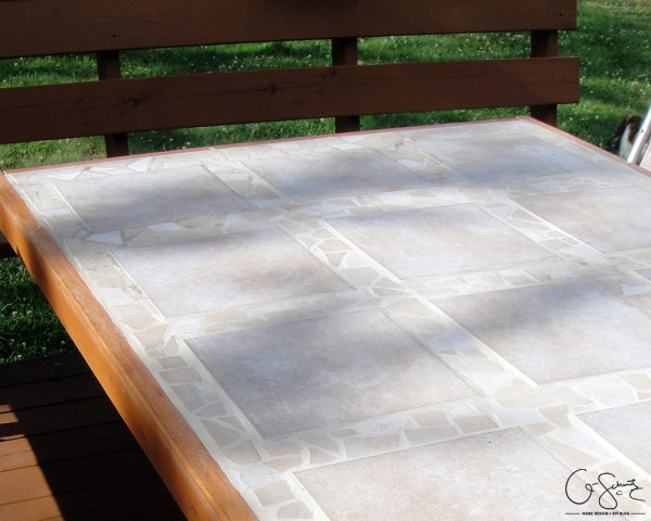 DIY Tiled patio table top by Q-Schmitz featured on @Remodelaholic