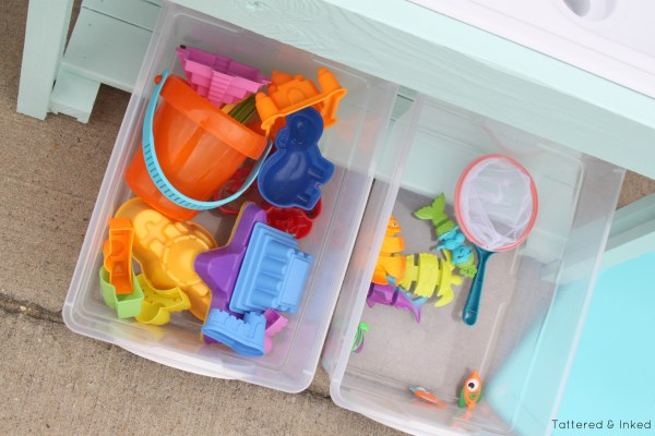 Kids water table with storiage, DIY by Tattered and Inked featured on @Remodelaholic