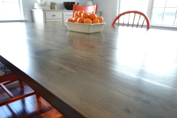 DIY table with seating for 12 by I am a Homemaker featured on @Remodelaholic