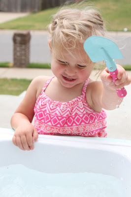 Tutorial for kids water table using a discarded kitchen sink by Tattered and Inked featured on @Remodelaholic