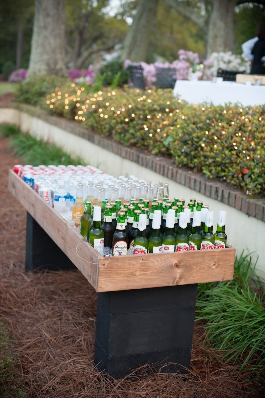 a shallow wood box on top of some cinder blocks makes an easy beverage cooler for a party, by MichaelaRaeJ