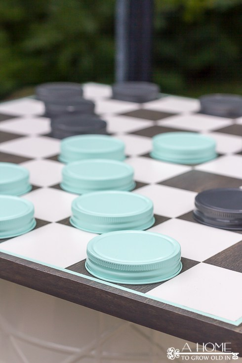 diy oversized checkerboard using mason jar lids as game pieces, A Home to Grow Old In