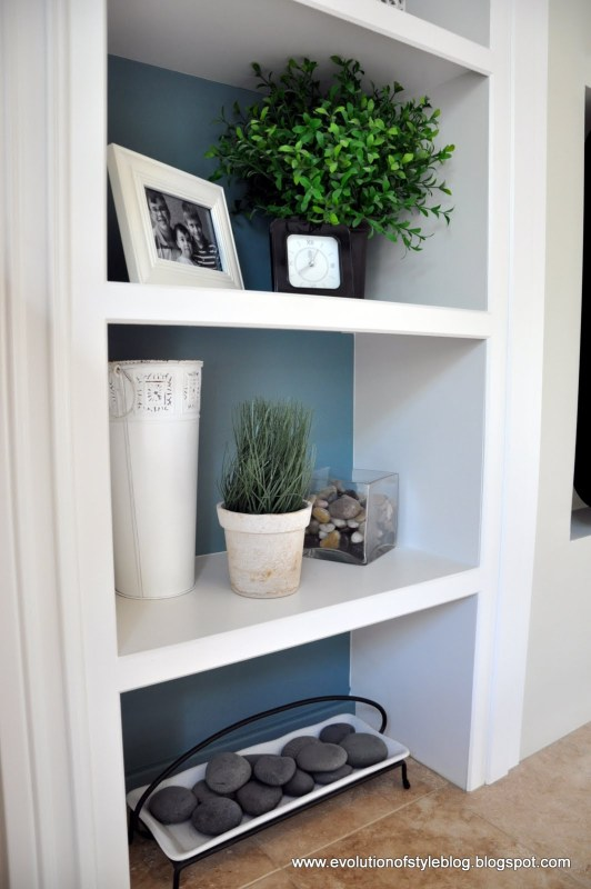 Inside of Bookshelves Painted with Aegean Tel Benjamin Moore. Color Spotlight on Remodelaholic.