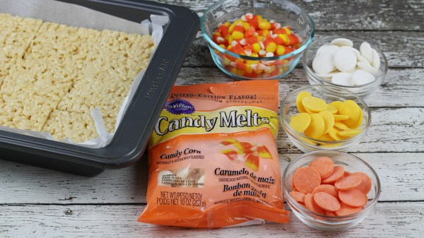 Get festive for Fall with these delicious fall candy corn rice krispies recipe via remodelaholic.com