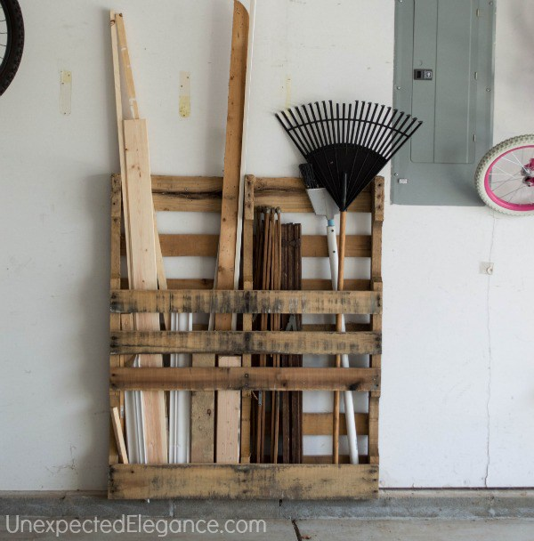 Garage organization and 16 clever organization pallet hacks featured on remodelaholic.com