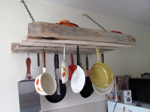 Pot organization in the kitchen. 16 clever organization pallet hacks featured on remodelaholic.com