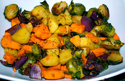 Thanksgiving Side Roasted Sweet Potatoes Yams And Brussels Sprouts