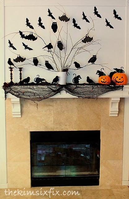 glowing Halloween silhouette mantle | DIY Halloween Decoration Ideas