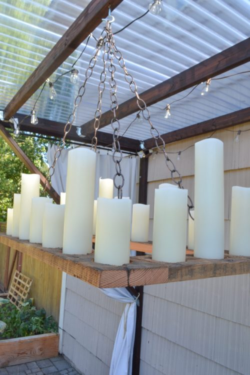 9 Remote Control Candles, Reclaimed Wood And Chains Make A Stunning Outdoor Chandelier, By The Creative Home Featured On @Remodelaholic