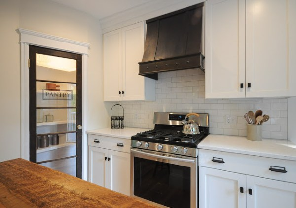 8 Custom Range Hood, Glass Pantry Door And Reclaimed Wood Countertop In Renovated Kitchen, By SoPo Cottage Featured On @Remodelaholic