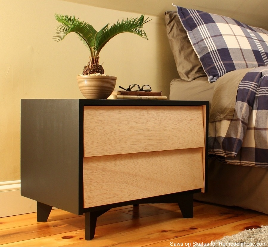 DIY Mid-Century Modern Nightstand | Free building plans and tutorial, including how to make the legs, slanted drawer fronts, and DIY drawer slides. Tutorial from Saws on Skates for Remodelaholic.com.