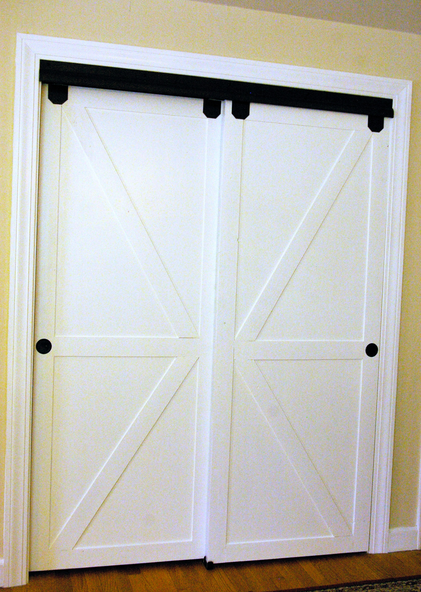 . Remodelaholic   How to Make Bypass Closet Doors Into Sliding Faux