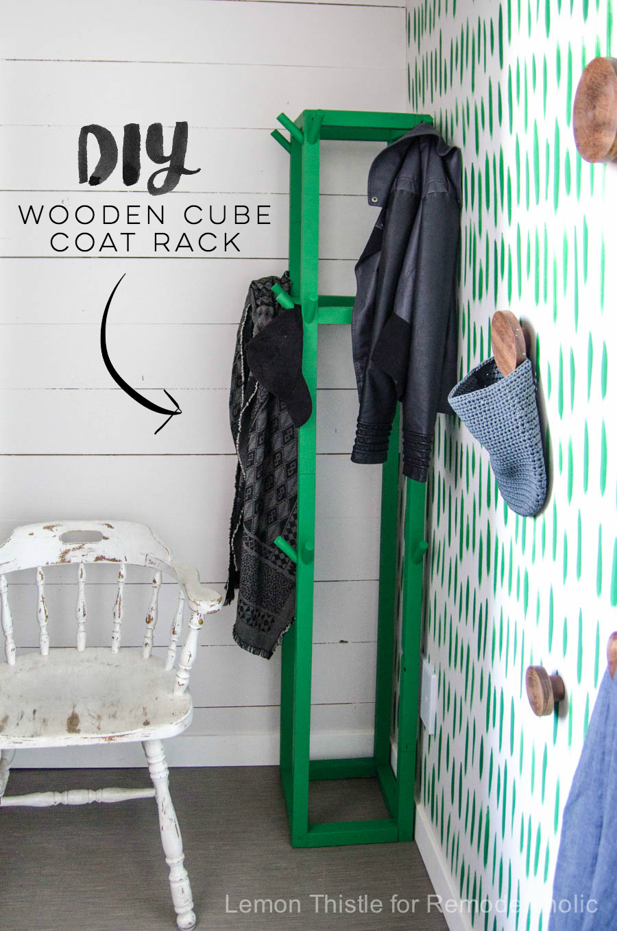 I love this DIY wooden coat rack- the cube shape and green paint is so fun! Plenty of room for guest's coats while entertaining, and the lower pegs make it kid-friendly, too. Build it for just $10 and some paint!
