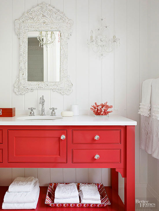 Bold Colorful Bathroom Inspiration | Bright Red Vanity with Ornate Mirror and Sconce
