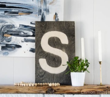 DIY Plywood Sign- simple and striking- I love the stained effect on this!