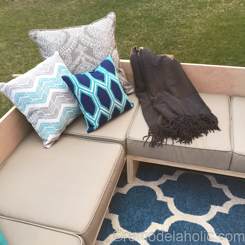 Build a plywood outdoor sofa sectional with affordable patio cushions | Woodworking plans from Remodelaholic #remodelaholic