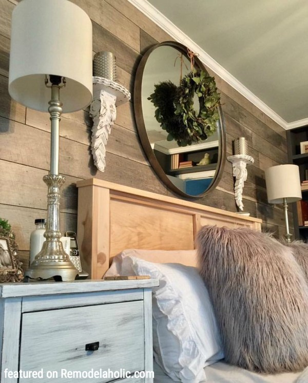 Gorgeous Wood Plank Feature Wall Using Clearance Flooring Featured On Remodelaholic.com