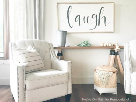 This DIY sawhorse sofa table by Twelve On Main is so cool!
