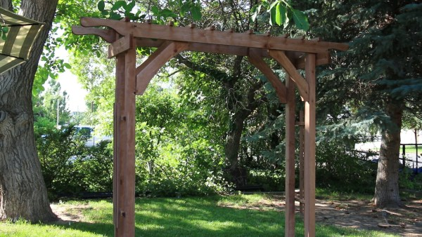 2x4 Garden Arbor, Wood Wedding Arch, perfect for the backyard featured on Remodelaholic.com