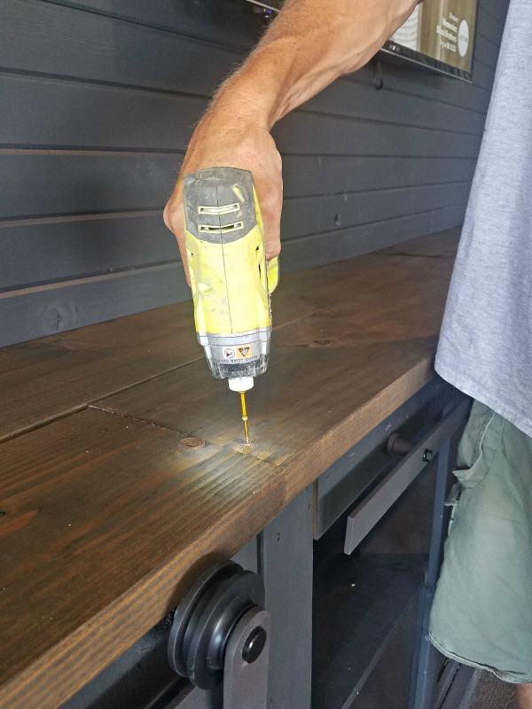 How To Build A Sliding Barn Door Console For Your Man Cave by Diva of DIY on Remodelaholic