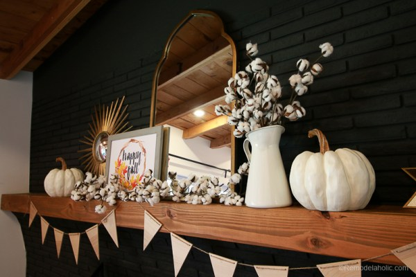 Simple fall mantel decor that transitions to easy DIY Halloween decorations #remodelaholic