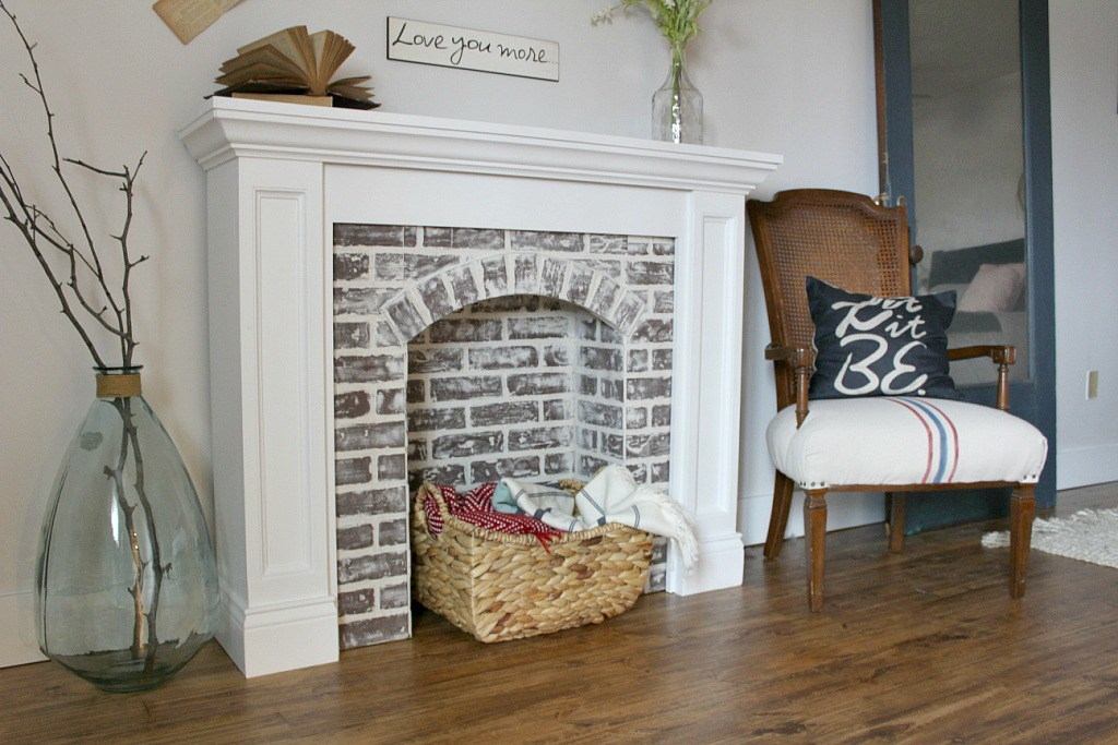 Remodelaholic 20 gorgeous diy faux fireplaces and mantels - How to make a brick fireplace look modern ...
