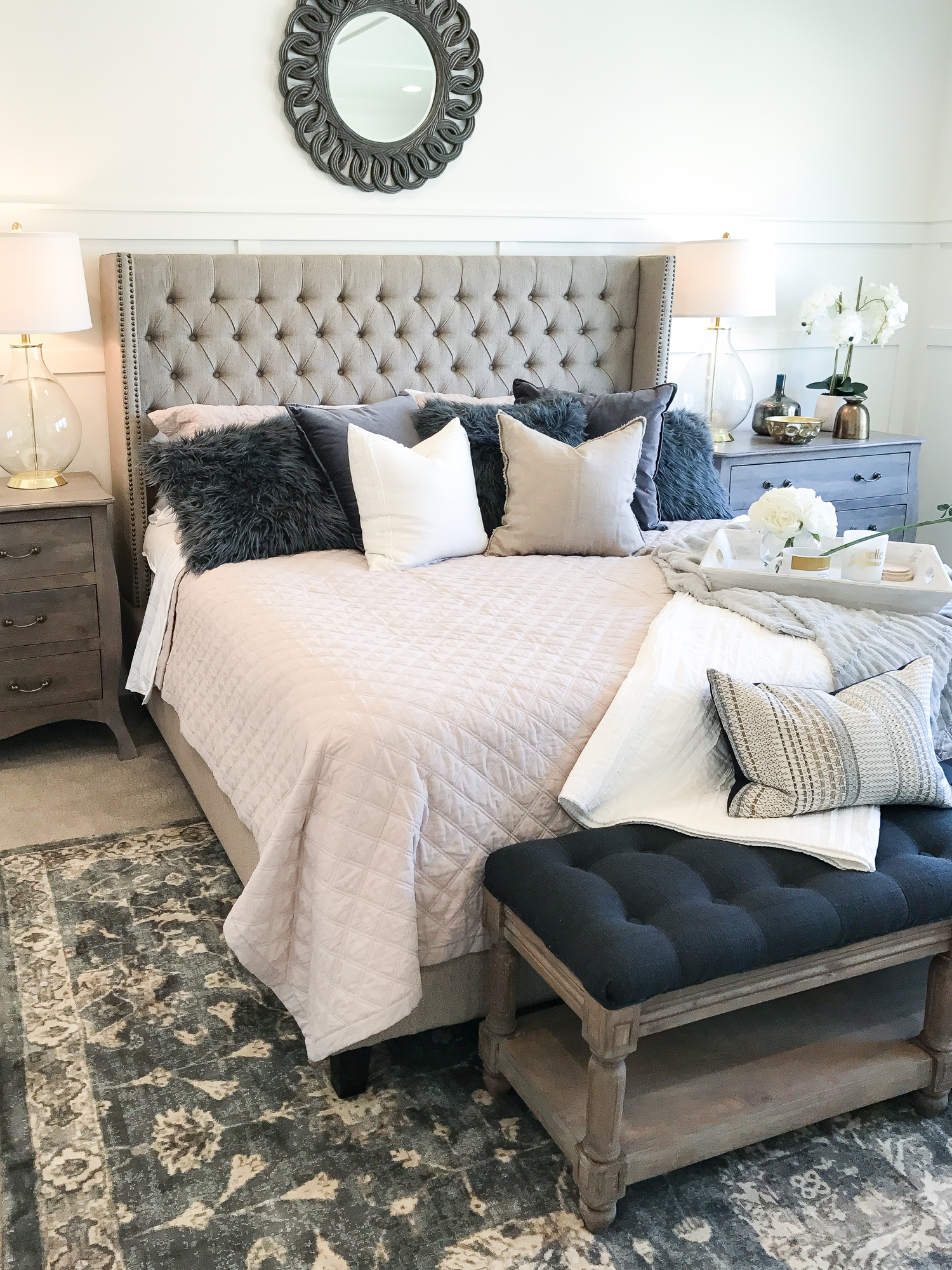 Cozy Luxe Bedroom with tufted headboard, white walls and shiplap ceiling.