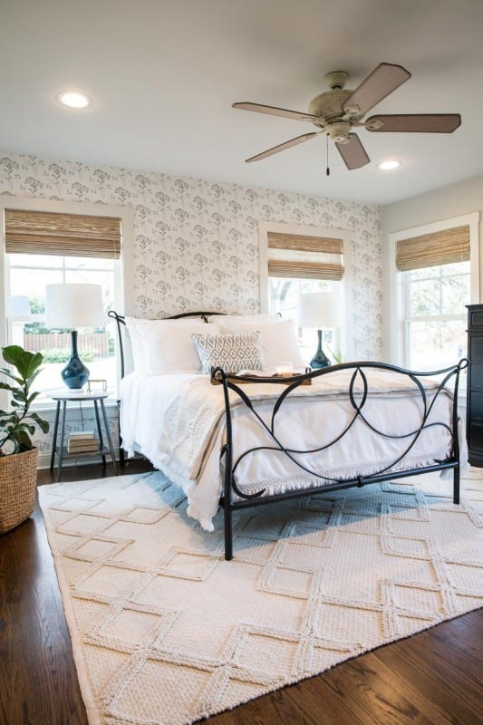 A beautiful neutral farmhouse style master bedroom makeover by Joanna Gaines. Find items to get the look inspired by the Fixer Upper Baker House Master Bedroom Makeover featured on Remodelaholic.com