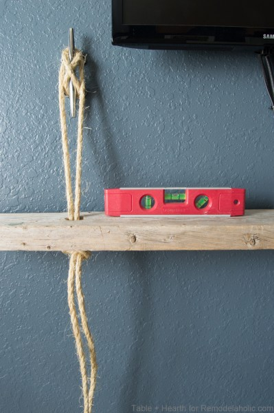 DIY reclaimed wood floating rope shelf tutorial | How to hang easy hanging rope shelves for decor and electronics #remodelaholic
