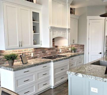 Homeshow @Remodelaholic White Kitchen With Brick Backsplash