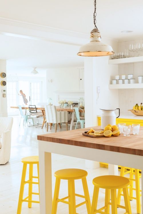 Neutral White With Sunny Yellow Kitchen Accents, Cabinets, Bar Stools Via  Style Carrot |