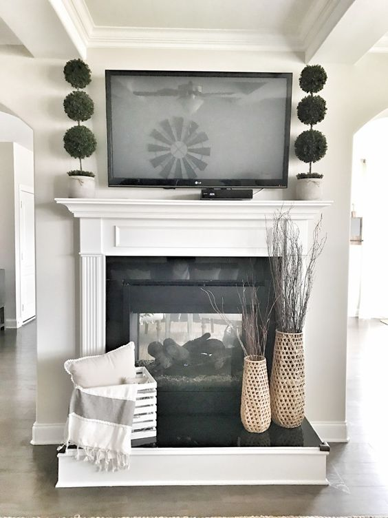 Ideas for Decorating Around a TV Over the Fireplace Mantel, simple farmhouse decor for a mantel and fireplace, via Bless this Nest