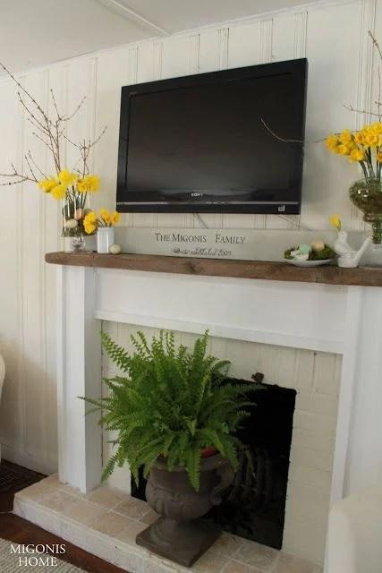 Ideas for Decorating Around a TV Over the Fireplace Mantel, simple white mantel decor via Migonis Home