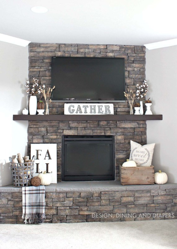 Ideas for Decorating Around a TV Over the Fireplace Mantel, stone fireplace and mantel decor via Design Dining and Diapers