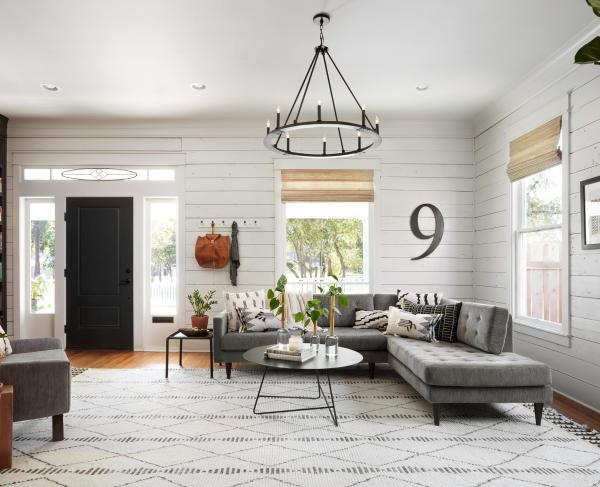 Get This Look: Fixer Upper Living Room from The Americana House   Recreate the iconic Joanna Gaines modern farmhouse chic style from the shiplap and neutral area rug to the chandelier and mid-century sofa with these tips, decorating picks, and DIY tutorials #getthislook #remodelaholic #fixerupper #modernfarmhouse