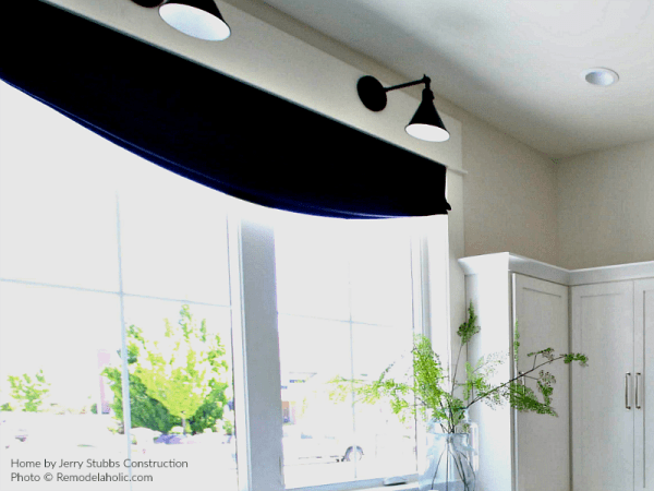 Roman Shade And Black Light Fixtures In White Laundry Room, Jerry Stubbs Construction And Tique And Company, 2018 Utah Valley Parade Of Homes Featured On Remodelaholic