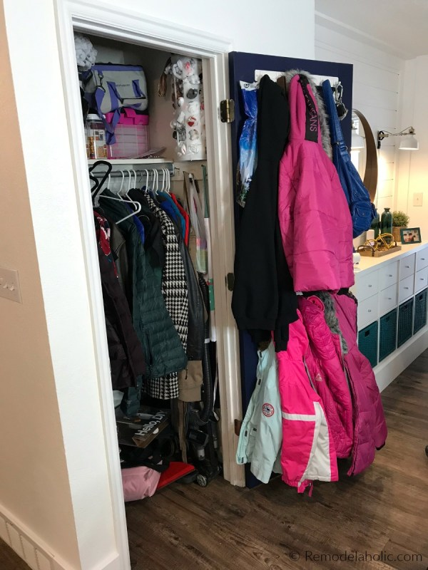 BEFORE: Small Entryway Coat Closet Organization Declutter Revamp With Double Hanging Bars And A Dual Duty Cleaning Closet Space #remodelaholic