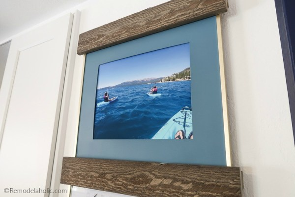 Easy Diy Picture Ledge Prevents Photo Frames From Tipping And Falling #remodelaholic