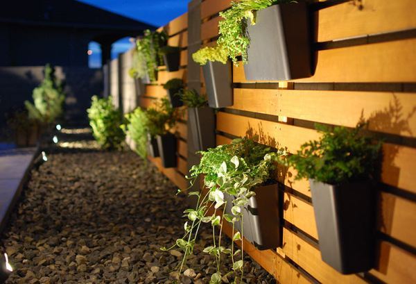 DIY Modern Wood Slat Garden Wall With Hanging Planters And Spotlights, The Garden Glove Featured On Remodelaholic