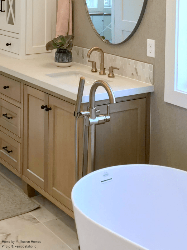 Gold Faucet Fixtures For Sink And Freestanding Tub In Master Bath, Millhaven Homes And Four Chairs Design, 2018 Utah Valley Parade Of Homes Featured On Remodelaholic