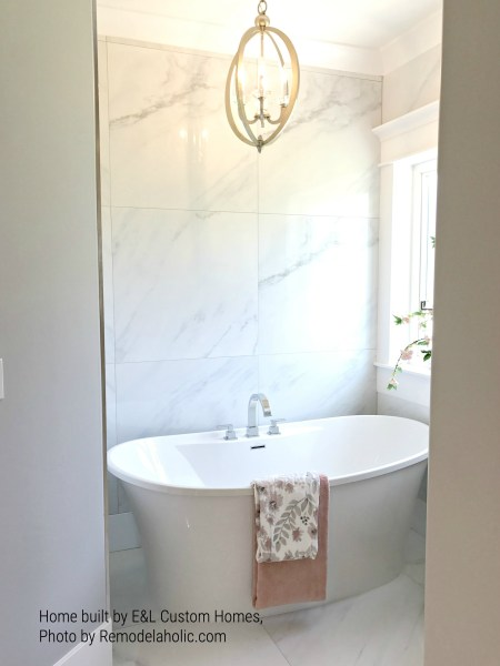 Bathtub In Private Nook With Window E&L Custom Homes (72).ed