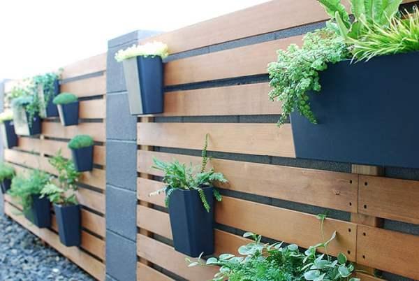 Tutorial, Modern Wood Slat Garden Wall Of Planters Using IKEA Sunnersta And Variera Kitchen Organizers, The Garden Glove Featured On Remodelaholic