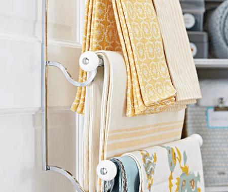 Linen Closet Makeover Towel Bars- BHG