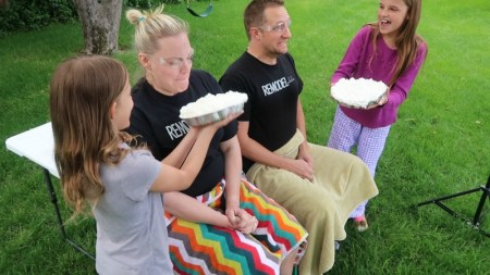 Mother Father And Two Siblings Get Ready For A Whip Cream Pie In The Face Baby Gender Reveal #remodelaholic