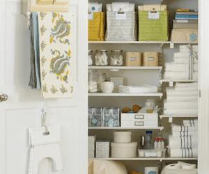 Organized Linen Closet With Baskets