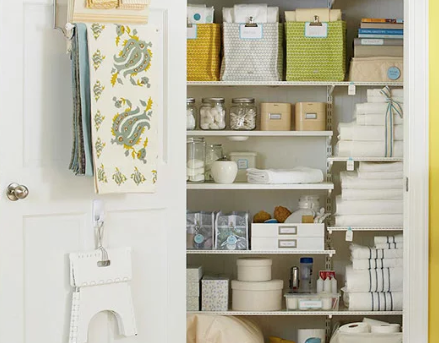 Organized Linen Closet With Baskets